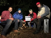 The team takes a break during a cold night shoot.